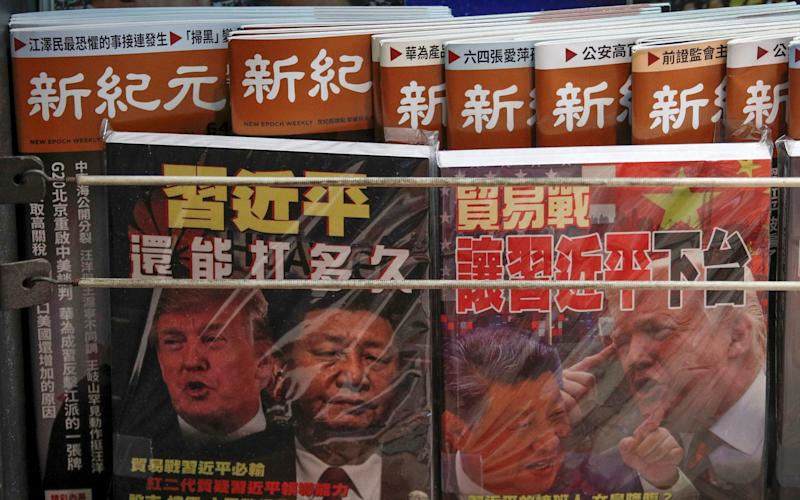 Chinese magazine covers with images of Donald Trump and Xi Jinping - AP