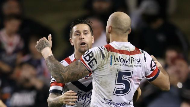 Pearce back with a bang as Roosters tame Tigers