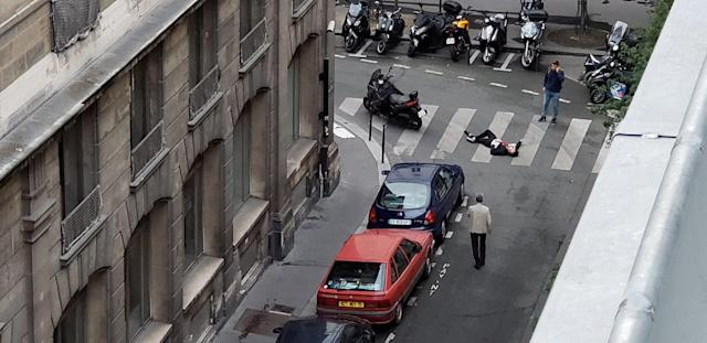 <p>A wounded man is seen on Rue Marsollier in Paris, France May 12, 2018 in this picture obtained from social media. (Photo: @DEZOUZART/Twitter via Reuters) </p>