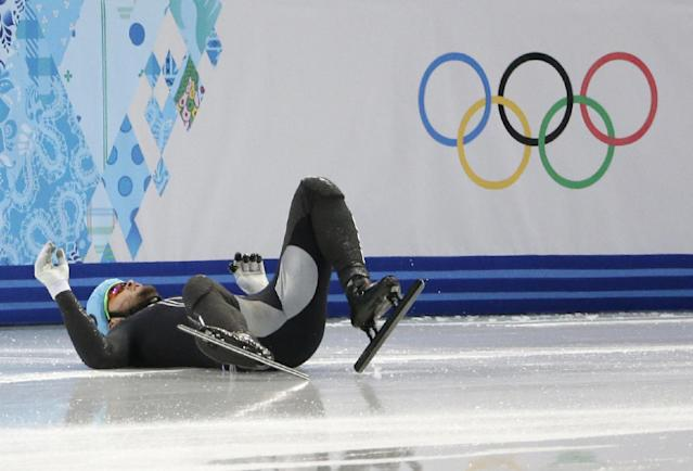 Eduardo Alvarez of the United States crashes out in a men's 500m short track speedskating heat at the Iceberg Skating Palace during the 2014 Winter Olympics, Tuesday, Feb. 18, 2014, in Sochi, Russia. (AP Photo/David J. Phillip )