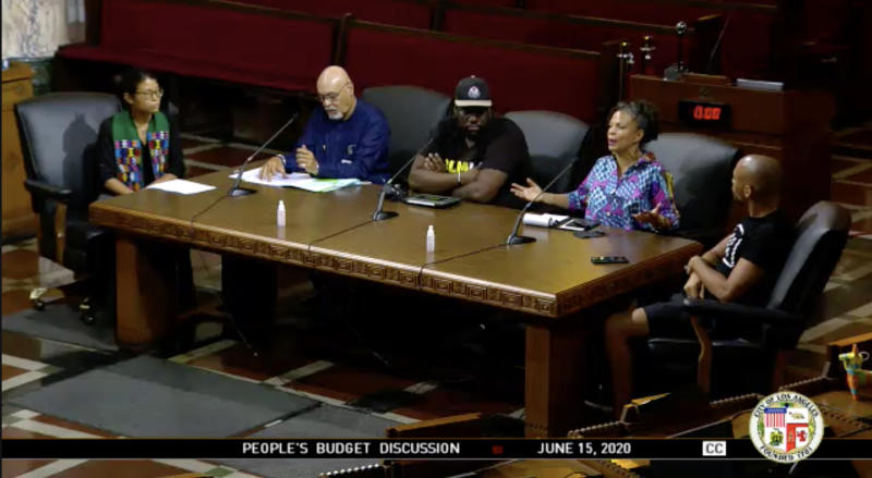 Image: David Turner, third left, and Melina Abdullah, second right, at the Los Angeles City Council meeting