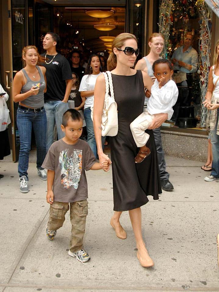 "Angelina Jolie leads Maddox and Zahara through the fans and paparazzi. Ronald Asadorian/<a href=""http://www.splashnewsonline.com"" target=""new"">Splash News</a> - August 24, 2007"