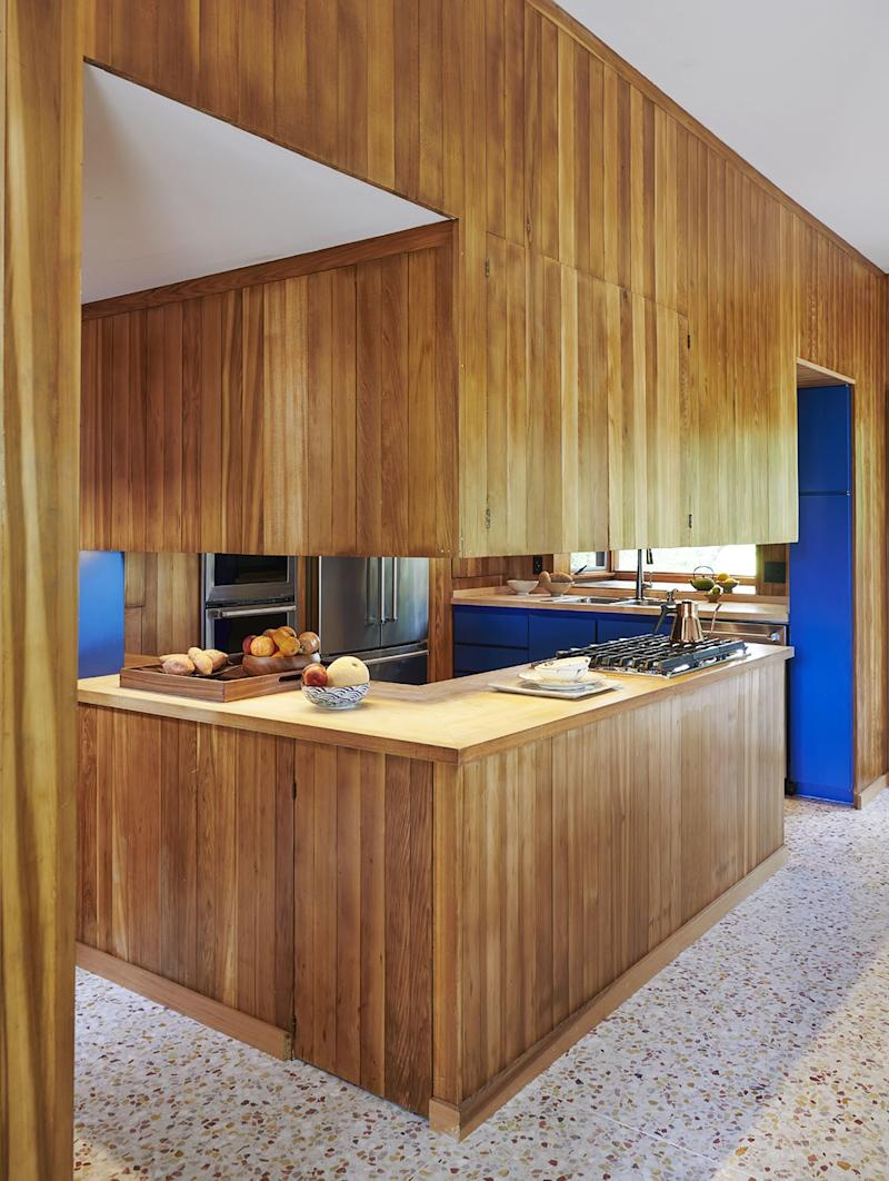 Terrazzo floors and cedar paneling make a statement in the kitchen.