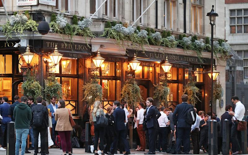 Drinkers outside the Red Lion, Westminster, this evening -  Yui Mok/PA