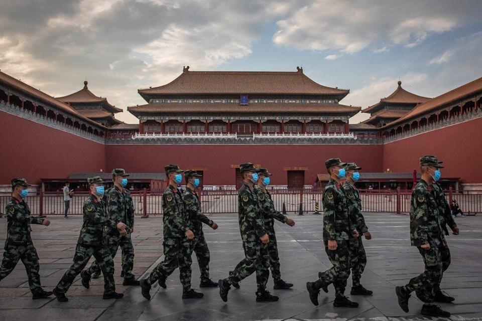 People's Liberation Army soldiers wearing protective face masks as they march past the Forbidden City in Beijing. The US has tightened export restrictions for products that could wind up used by the PLA. Photo: EPA-EFE