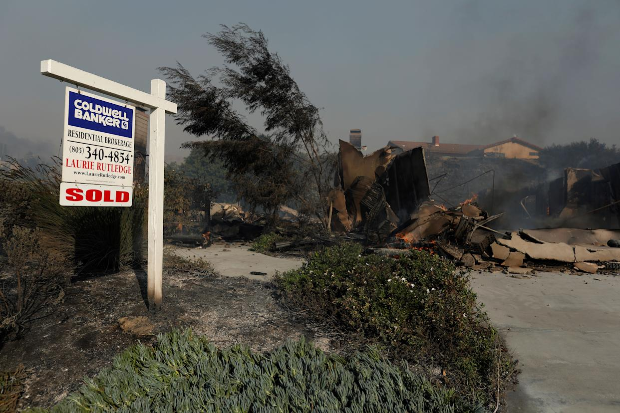 A real estate sign was barely touched by a fire that burned a home to the ground in Ventura County.