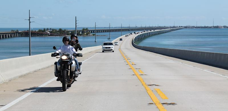 In this February 2012 photo motorcyclists ride on Seven Mile Bridge along the Overseas Highway, U.S. 1, which connects Knight's Key in Marathon, Fla. with Little Duck Key. (AP Photo/Glenn Adams)