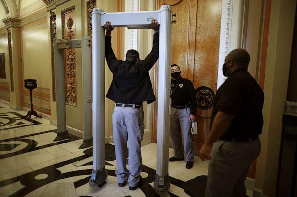 PHOTO: U.S. Capitol Police install a metal detector at the doors of the House Chamber Jan. 12, 2021 in Washington, D.C. (Chip Somodevilla/Getty Images)