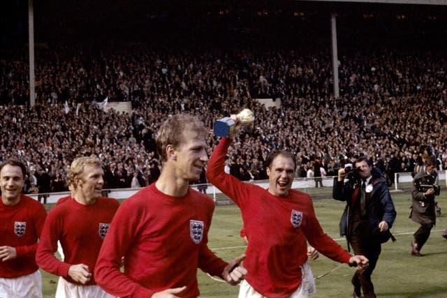 England's George Cohen, Bobby Moore, Jack Charlton and Ray Wilson (with trophy) celebrate after winning the World Cup in 1966