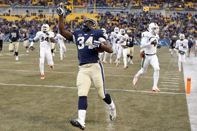 Pittsburgh running back Isaac Bennett (34) celebrates as he runs past the Miami defense for a touchdown in the first quarter of an NCAA college football game in Pittsburgh on Friday, Nov. 29, 2013. (AP Photo/Keith Srakocic)