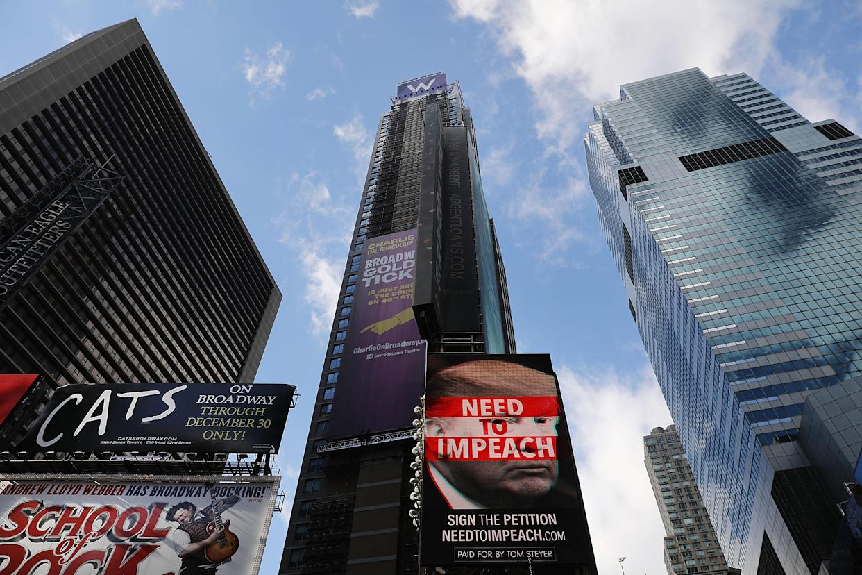 A Times Square billboard funded by Tom Steyer calls for the impeachment of President Trump. (Photo: Spencer Platt/Getty Images)