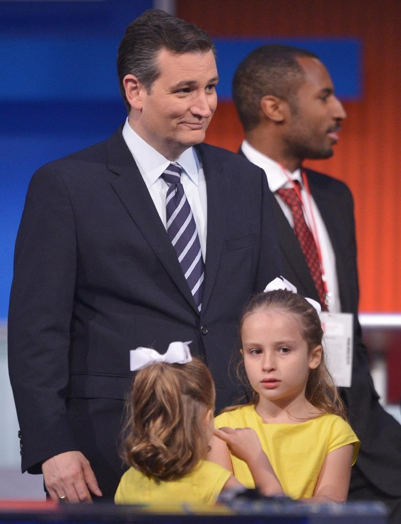 "Ted Cruz, pictured with his daughters after the prime time Republican presidential primary debate on August 6, 2015, called for a new commander in chief who ""will stand up to our enemies"" (AFP Photo/Mandel Ngan)"
