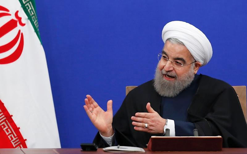 Iranian President Hassan Rouhani gives a press conference in Tehran on Jaunary 17, 2017, to mark the first anniversary of the implementation of the historic nuclear deal
