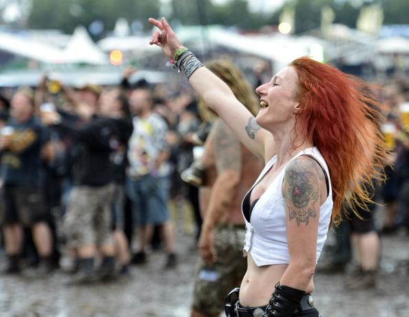 A festival goer enjoys the Wacken Open Air heavy metal music fest on August 3, 2012 in Wacken, Germany. Approximately 75,000 heavy metal fans from all over the world have descended on the north German village of 1,800 residents for the annual three-day fest. (Photo by Patrick Lux/Getty Images)