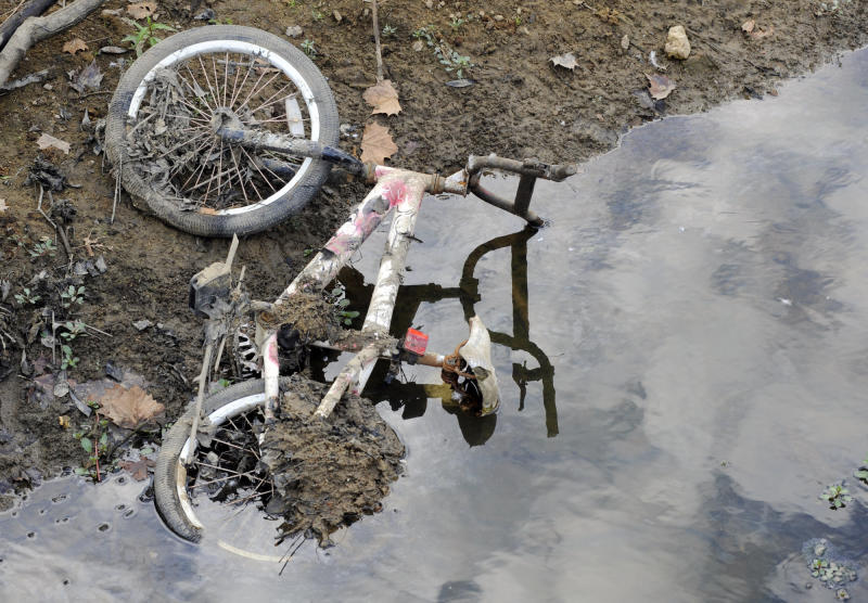 A bicycle that was submerged in a pond lies on a dried-up bank in Helena, Ala., on Thursday, Sept. 26, 2019. Weeks of dry, hot weather have plunged the Deep South further into a drought that a federal assessment says is affecting more than 11 million people and threatening crops across a five-state region. (AP Photo/Jay Reeves)