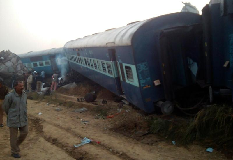 Train derails in north India, killing 104; many trapped
