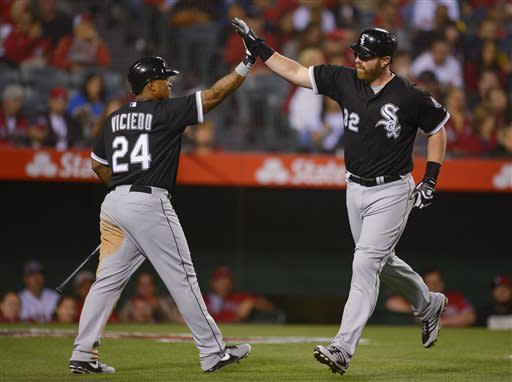 Chicago White Sox first baseman Adam Dunn (32) is greeted by Chicago White Sox left fielder Dayan Viciedo (24) after hitting a solo home run against the Los Angeles Angels in the ninth inning of a baseball game, Friday, May 17, 2013 in Anaheim, Calif. (AP Photo/Mark J. Terrill)