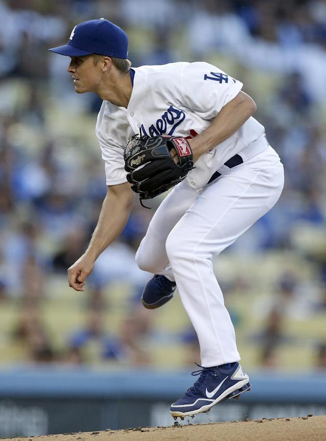 Los Angeles Dodgers starting pitcher Zack Greinke watches a delivery to a New York Yankees batter during first inning of a baseball game in Los Angeles, Tuesday, July 30, 2013. (AP Photo/Chris Carlson)