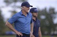 Greg Norman, left, of Australia, walks with his son Greg Norman Jr. on the 18th fairway after hitting their tee shots during the first round of the PNC Championship golf tournament, Saturday, Dec. 19, 2020, in Orlando, Fla. (AP Photo/Phelan M. Ebenhack)