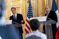 US Secretary of State Antony Blinken, left, accompanied by French Foreign Affairs Minister Jean-Yves Le Drian, right, speaks at a news conference at the French Ministry of Foreign Affairs in Paris, Friday, June 25, 2021. Blinken is on a week long trip in Europe traveling to Germany, France and Italy. (AP Photo/Andrew Harnik, Pool)