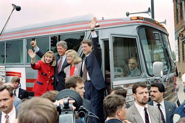 PHOTO: Democratic Presidential candidate Bill Clinton and running mate Al Gore wave to supporters before boarding their bus in Columbus, Georgia, Sept. 23, 1992. (Paul J. Richards/AFP/Getty Images, FILE)