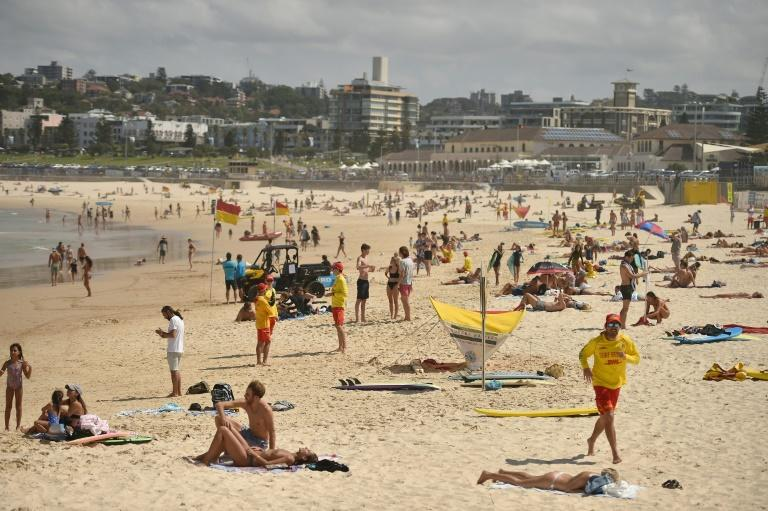 Bondi Beach was closed after sunbathers flouted a ban on non-essential outdoor gatherings of more than 500 people (AFP Photo/PETER PARKS)