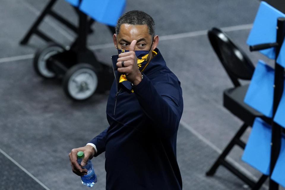 Michigan head coach Juwan Howard celebrates as he walks off the court after a Sweet 16 game against Florida State in the NCAA men's college basketball tournament at Bankers Life Fieldhouse, Sunday, March 28, 2021, in Indianapolis. Michigan won 76-58. (AP Photo/Darron Cummings)