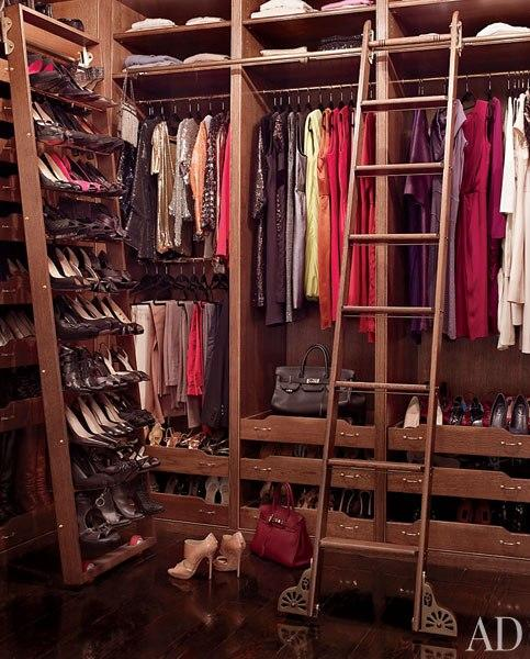 Actress Brooke Shields's closet at her Greenwich Village townhouse was built of rift-sawn white oak by Brooklyn-based design/build firm MADE. The compact space makes use of a rolling shoe rack and library ladder, helping to maximize storage and accessibility. (March 2012)