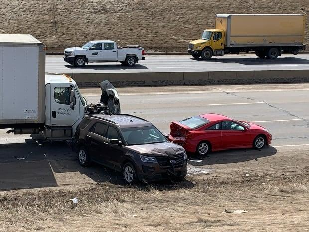 An Edmonton police officer was hurt Monday morning in this crash in the westbound lanes of Whitemud Drive near 91st Street. (David Bajer/CBC - image credit)