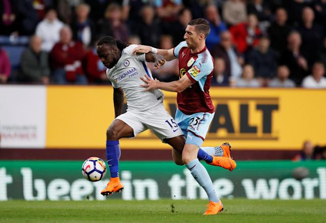 "Soccer Football - Premier League - Burnley vs Chelsea - Turf Moor, Burnley, Britain - April 19, 2018 Chelsea's Victor Moses in action with Burnley's Stephen Ward Action Images via Reuters/Andrew Boyers EDITORIAL USE ONLY. No use with unauthorized audio, video, data, fixture lists, club/league logos or ""live"" services. Online in-match use limited to 75 images, no video emulation. No use in betting, games or single club/league/player publications. Please contact your account representative for further details."