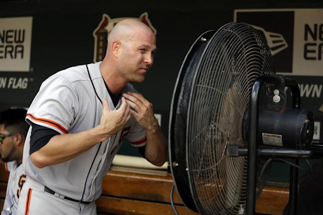 San Francisco Giants starting pitcher Tim Hudson cools off in the dugout after working the fifth inning of a baseball game against the St. Louis Cardinals, Sunday, June 1, 2014, in St. Louis. (AP Photo/Jeff Roberson)