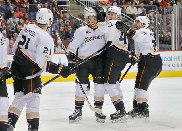 FILE - In this Jan. 11, 2014, file photo, Anaheim Ducks' Hampus Lindholm (47) celebrates his goal with teammates Nick Bonino, right, Francois Beauchemin and Kyle Palmieri (21) during the first period of an NHL hockey game against the Phoenix Coyotes in Glendale, Ariz. The Ducks have reached rarefied air while winning 18 of their last 19 games, reigning atop the NHL standings with their high-scoring, fun-filled brand of hockey. (AP Photo/Matt York, File)