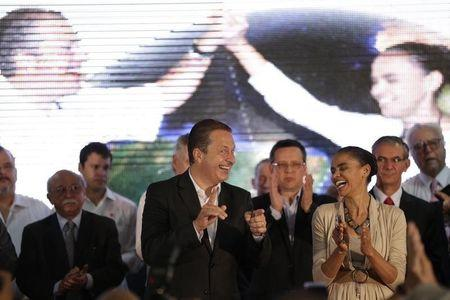 Former governor of Pernambuco state Eduardo Campos talks with former Senator Marina Silva during a ceremony to announce their candidacies for president and vice president of Brazil in the general elections to be held next October, in Brasilia April 14, 2014. REUTERS/Ueslei Marcelino