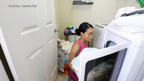 PHOTO: Jessica Null does laundry for a YouTube video of cleaning her home. (Jessica Null)