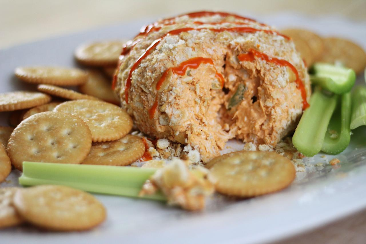 """<p>The buffalo flavor that we all know and love is typically made by combining vinegar, butter, and a cayenne pepper-based hot sauce. Skip the intense prep that buffalo wings require-- get all of the flavor you crave with a buffalo cheese ball. Prepared Buffalo wing sauce makes it easy to make and the blue cheese gives each bite an addictive richness. Serve while watching the next big game with your friends. </p> <p><a href=""""https://www.myrecipes.com/recipe/buffalo-chicken-cheese-ball"""">Buffalo Chicken Cheese Ball Recipe</a></p>"""