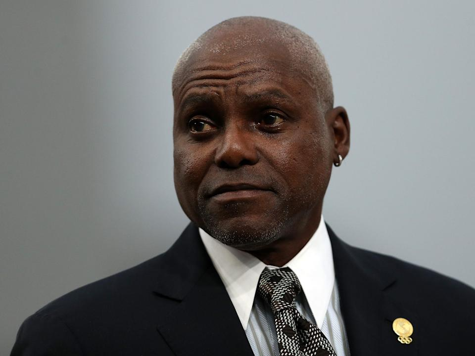 Carl Lewis today in a suit and tie