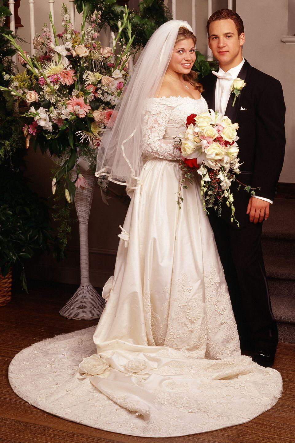 <p>Cory and Topanga seemed destined for each other when they met in Mr. Feeney's classroom in season 1—where Topanga first kissed him. They tied the knot in season 7, and she wore a lacy, long-sleeve, off-the-shoulder gown with a train. </p>