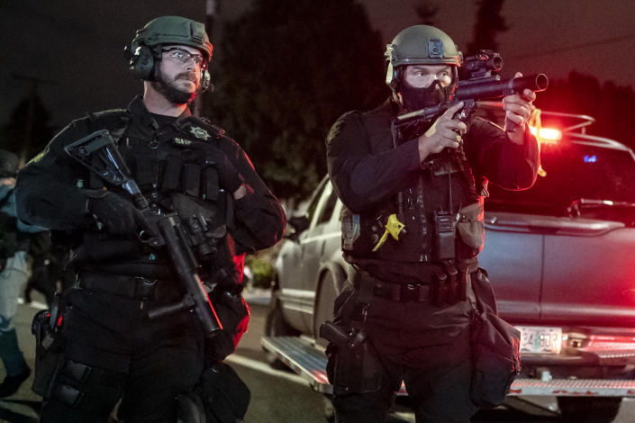 A Multnomah County Sheriffs deputy points a less lethal weapon at anti-police protesters near the Portland east police precinct a day after political violence left one person dead on August 30, 2020 in Portland, Oregon. (Nathan Howard/Getty Images)