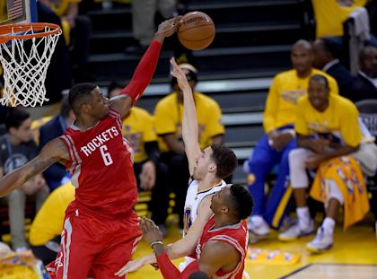 Terrence Jones blocks Klay Thompson's shot in last year's Western Conference Finals. (Getty)