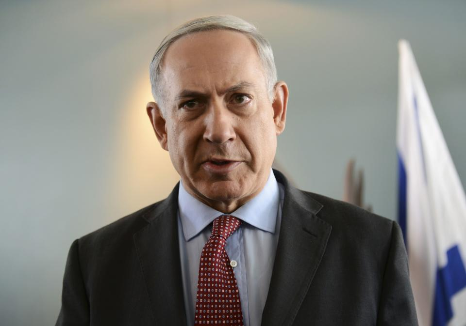 Israeli Prime Minister Benjamin Netanyahu delivers a statement to the media after meeting U.S. Secretary of State John Kerry at Ben Gurion Airport near Tel Aviv November 8, 2013. Israel rejected out of hand on Friday a mooted deal between world powers and Iran, just as Kerry prepared to join nuclear talks that aim to nail down an interim agreement on the decade-old standoff. REUTERS/Debbie Hill/Pool (ISRAEL - Tags: POLITICS)