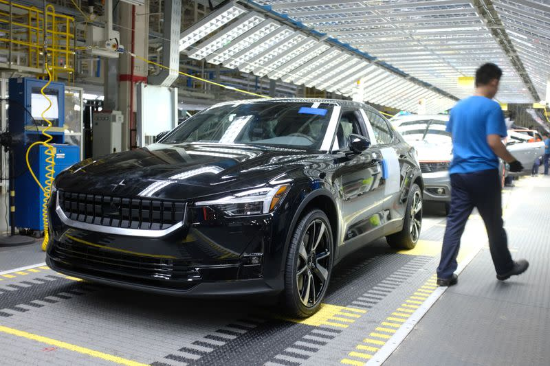 Workers are seen on a production line for Polestar, Volvo and Lynk&Co vehicles at a Geely plant in Taizhou