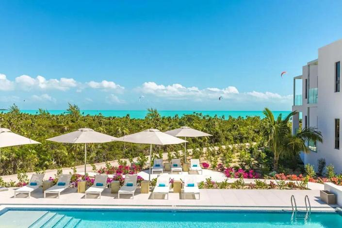 """<p><strong>Oranjestad, Aruba</strong></p> <p>Taking your pet on an island vacation? Lucky dog. (Sorry, had to.) The Modern Studio Condo in Aruba is only a 10-minute drive from the airport and comes fully stocked with a pair of bikes, beach towels, and chairs. Natural wood accents and crisp, white linens are always a winning combination, and you can kick back and relax on the emerald sitting chair or enjoy a home-cooked meal inside the full kitchen. Within walking distance are tons of local eateries and access to the beach.</p> $385, Airbnb. <a href=""""https://www.airbnb.com/rooms/48051792"""" rel=""""nofollow noopener"""" target=""""_blank"""" data-ylk=""""slk:Get it now!"""" class=""""link rapid-noclick-resp"""">Get it now!</a>"""
