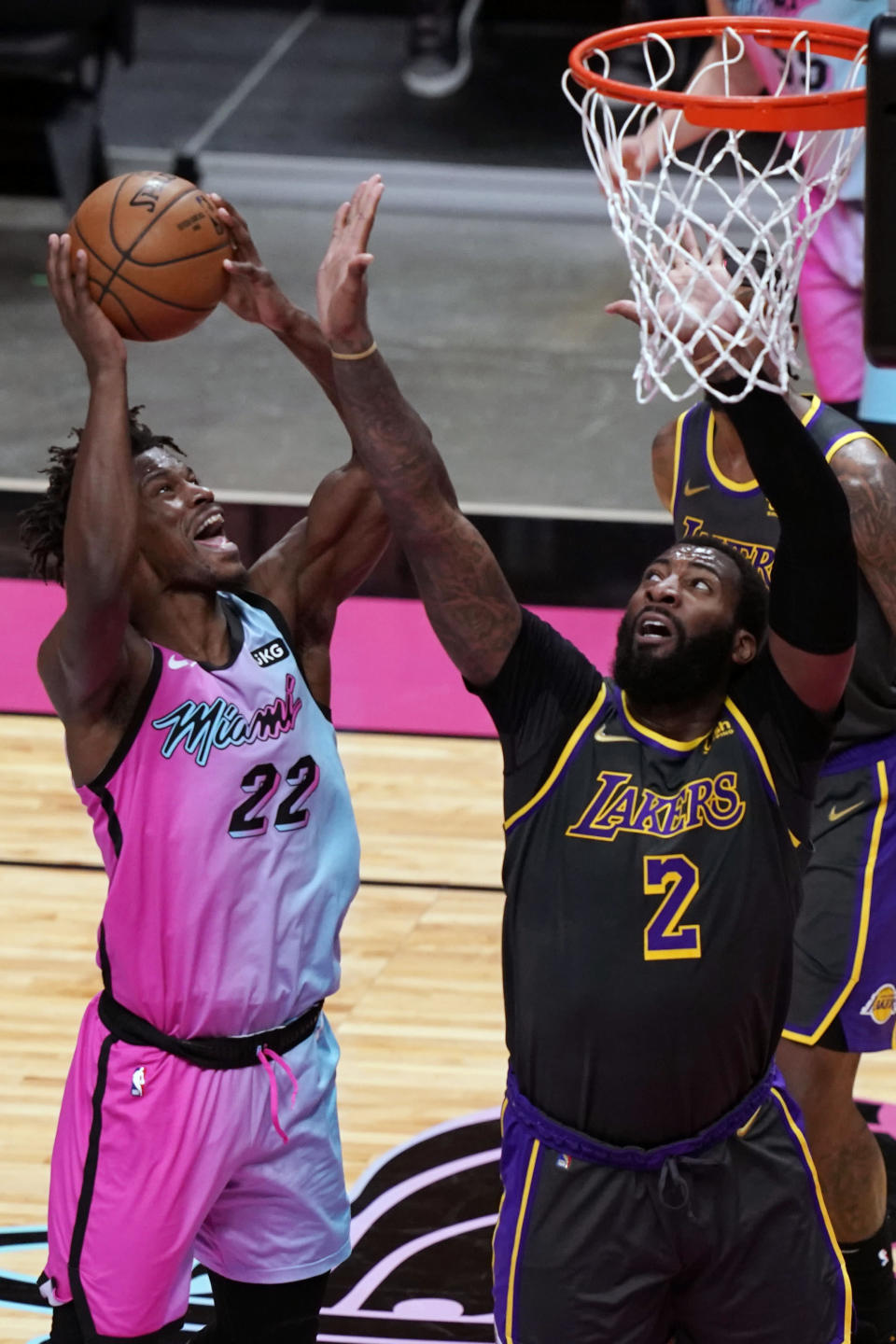 Miami Heat forward Jimmy Butler (22) drives to the basket as Los Angeles Lakers center Andre Drummond (2) defends, during the second half of an NBA basketball game, Thursday, April 8, 2021, in Miami. (AP Photo/Marta Lavandier)