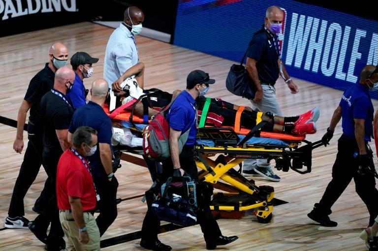Miami forward Derrick Jones Jr. is tended to by medical personnel after colliding with Goga Bitadze Indiana in the Heat'S 109-92 NBA loss to the Pacers