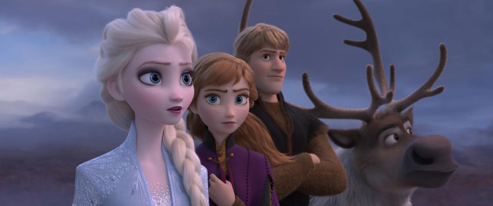 "This image released by Disney shows Elsa, voiced by Idina Menzel, from left, Anna, voiced by Kristen Bell, Kristoff, voiced by Jonathan Groff and Sven in a scene from the animated film, ""Frozen 2."" (Disney via AP)"