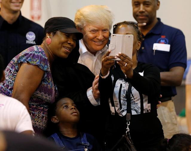 <p>President Donald Trump poses for a photo with a family at a Hurricane Relief Center where he met with flood survivors of Hurricane Harvey, in Houston, Texas, Sept. 2, 2017. (Photo: Kevin Lamarque/Reuters) </p>