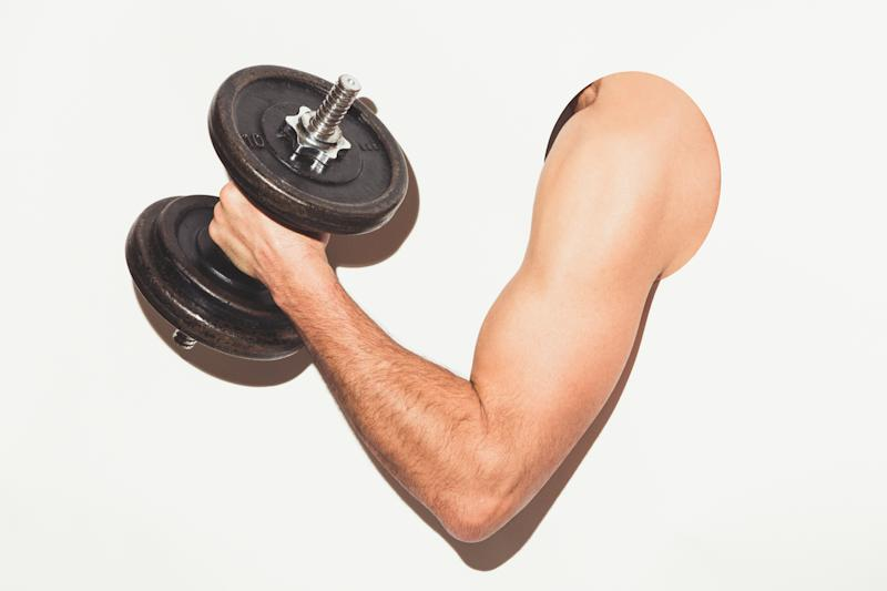 Pictured: Male arm lifts weights. Image: Getty