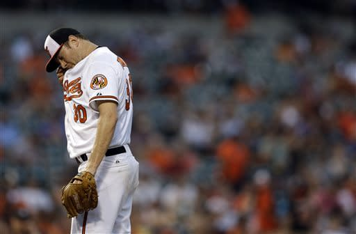 Baltimore Orioles starting pitcher Chris Tillman pauses to wipe sweat from his face in the fifth inning of a baseball game against the Cleveland Indians, Tuesday, June 25, 2013, in Baltimore. Tillman allowed a two-run home run in the fifth. (AP Photo/Patrick Semansky)