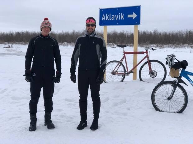 Matt Lee, right, and Chris Bruckner are organizing a 120-kilometre ride from Inuvik, N.W.T., to Aklavik, N.W.T., in honour of their friend Matt Hamilton. (Mackenzie Scott/CBC - image credit)