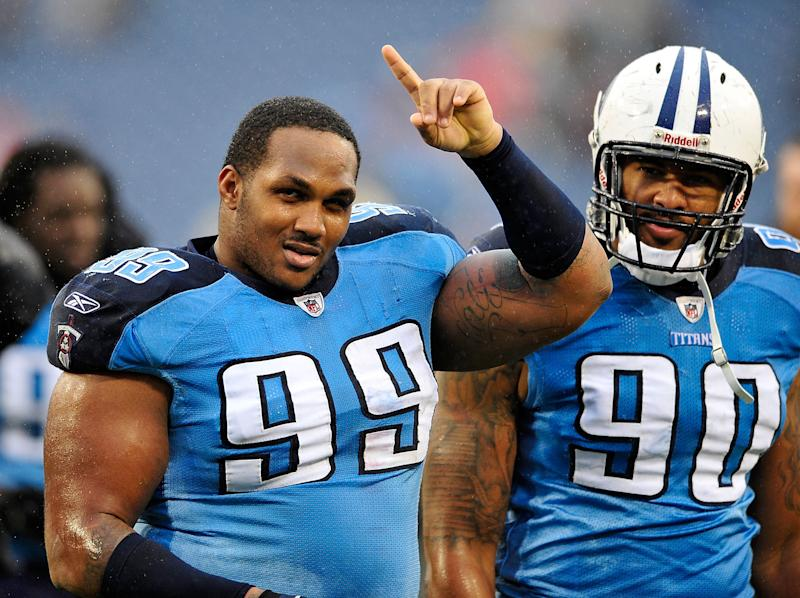 In this file photo, Jurrell Casey (L) and Derrick Morgan of the Tennessee Titans are seen leaving the field after a win over the Tampa Bay Buccaneers, at LP Field in Nashville, Tennessee, on November 27, 2011
